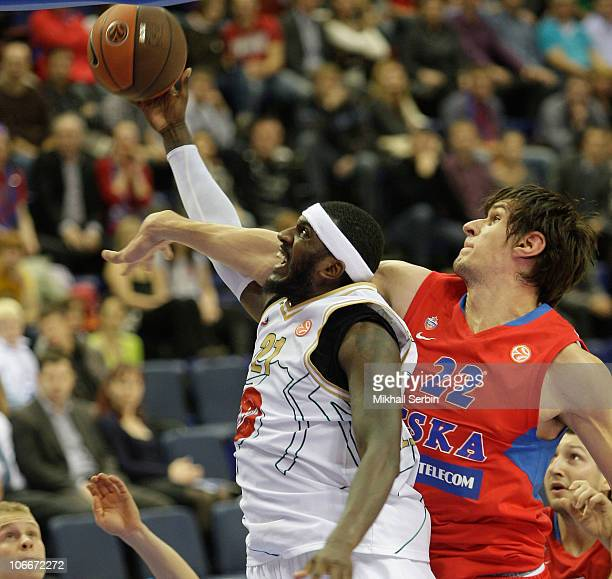 Kevinn Pinkney, #21 of Union Olimpija competes with Boban Marjanovic, #22 of CSKA Moscow during the Turkish Airlines Euroleague Day 4 game between...