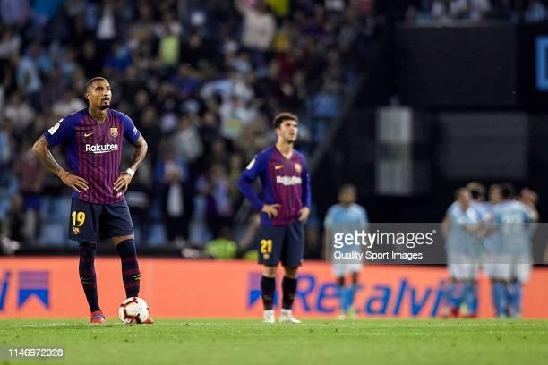 KevinPrince Boateng and Carles Alena of FC Barcelona react after Maxi Gomez of Celta de Vigo scores his team first goal during the La Liga match...