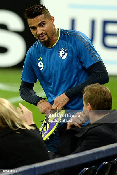 KevinPrince Boateng attends a FC Schalke 04 training session prior to their UEFA Champions League Group E qualification match against Chelsea FC at...