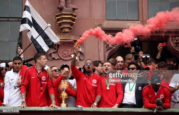 KevinPrince Boateng fire a bengalo and celebrates with his team of Frankfurt the winning DFB Cup at the Roemer on May 20 2018 in Frankfurt am Main...