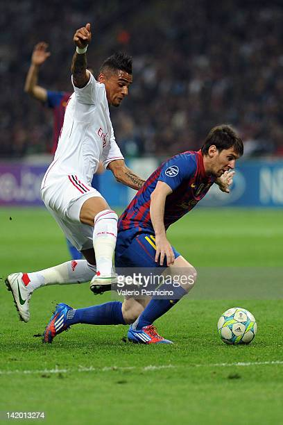 KevinPrince Boateng of AC Milan competes with Lionel Messi of FC Barcelona during the UEFA Champions League quarter final first leg match between AC...