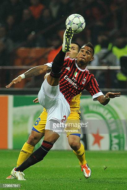 Kevin-Prince Boateng of AC Milan in action against Aleksandr Volodko of FC BATE Borisov during the UEFA Champions League group H match between AC...