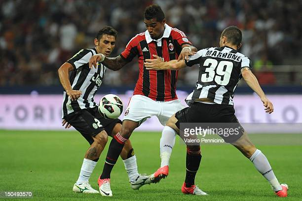 KevinPrince Boateng of AC Milan is challenged by Luca Marrone and Michele Pazienza of Juventus FC during the Berlusconi Trophy match between AC Milan...