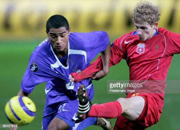 KevinPrince Boateng of Berlin tussles for the ball with Mihai Nesu of Bucharest during the UEFA Cup Group C match between Hertha BSC Berlin and FC...