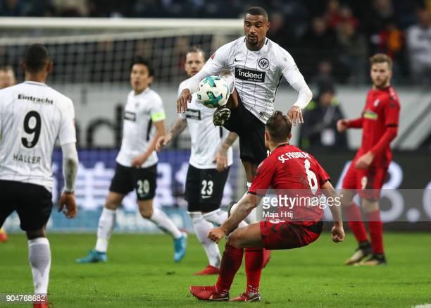 KevinPrince Boateng of Eintracht Frankfurt and Amir Abrashi of SC Freiburg battle for the ball during the Bundesliga match between Eintracht...