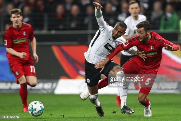 KevinPrince Boateng of Eintracht Frankfurt and Manuel Gulde of SC Freiburg battle for the ball during the Bundesliga match between Eintracht...