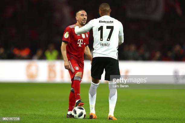 KevinPrince Boateng of Eintracht Frankfurt talks to Franck Ribery of Bayern Muenchen during the DFB Cup final between Bayern Muenchen and Eintracht...