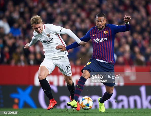 KevinPrince Boateng of FC Barcelona competes for the ball with Simon Kjaer of Sevilla FC during the Copa del Quarter Final match between Sevilla FC...