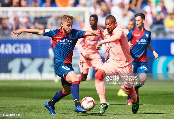 KevinPrince Boateng of FC Barcelona duels for the ball with Jorge Pulido of SD Huesca during the La Liga match between SD Huesca and FC Barcelona at...