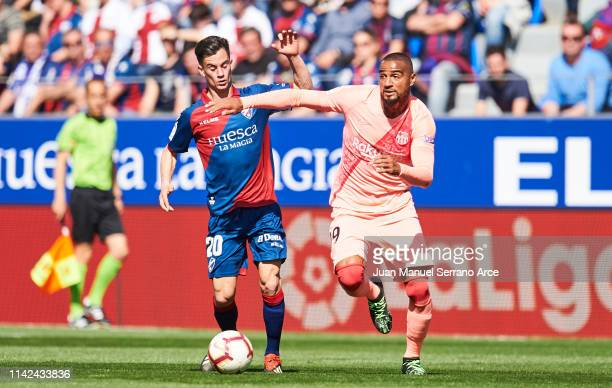 KevinPrince Boateng of FC Barcelona duels for the ball with Juan Pablo Anor of SD Huesca during the La Liga match between SD Huesca and FC Barcelona...