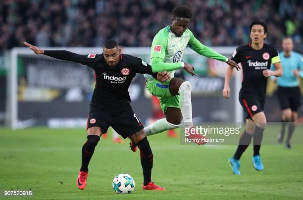 KevinPrince Boateng of Frankfurt and Divock Origi of Wolfsburg vie during the Bundesliga match between VfL Wolfsburg and Eintracht Frankfurt at...