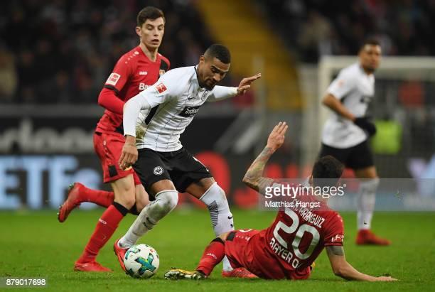 KevinPrince Boateng of Frankfurt is challenged by Charles Aranguiz of Leverkusen during the Bundesliga match between Eintracht Frankfurt and Bayer 04...