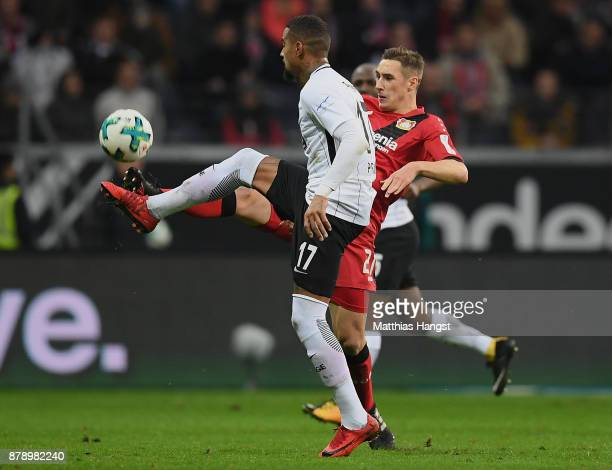 KevinPrince Boateng of Frankfurt is challenged by Dominik Kohr of Leverkusen during the Bundesliga match between Eintracht Frankfurt and Bayer 04...