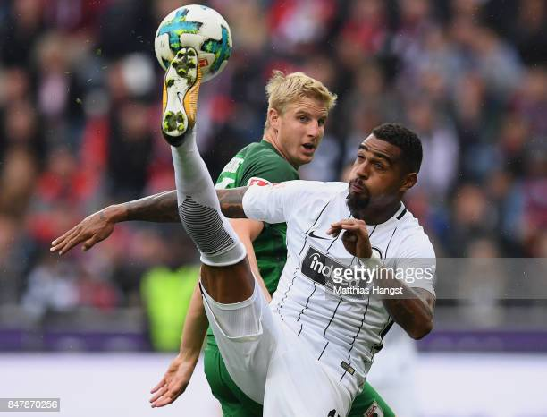 KevinPrince Boateng of Frankfurt is challenged by Martin Hinteregger of Augsburg during the Bundesliga match between Eintracht Frankfurt and FC...