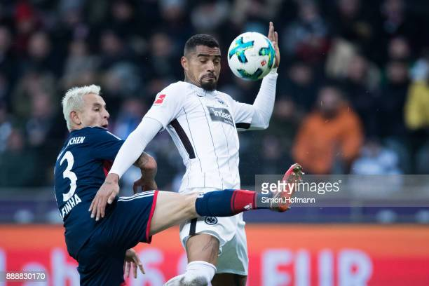 KevinPrince Boateng of Frankfurt is challenged by Rafinha of Muenchen during the Bundesliga match between Eintracht Frankfurt and FC Bayern Muenchen...