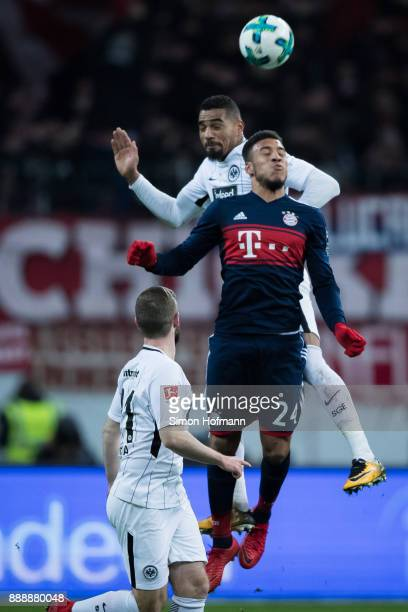 KevinPrince Boateng of Frankfurt jumps for a header with Corentin Tolisso of Muenchen during the Bundesliga match between Eintracht Frankfurt and FC...