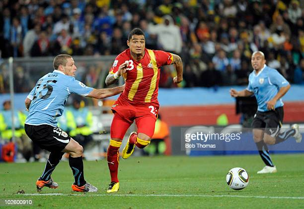 KevinPrince Boateng of Ghana moves past Diego Perez of Uruguay during the 2010 FIFA World Cup South Africa Quarter Final match between Uruguay and...