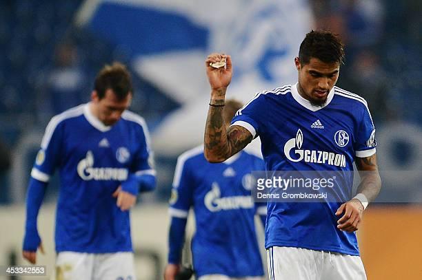 KevinPrince Boateng of Schalke 04 shows his frustration after the DFB Cup match between Schalke 04 and 1899 Hoffenheim at VeltinsArena on December 3...