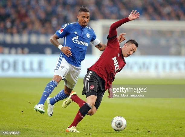 KevinPrince Boateng of Schalke and Josip Drmic of Nuernberg battle for the ball during the Bundesliga match between FC Schalke 04 and 1 FC Nuernberg...
