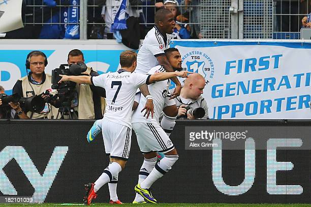 KevinPrince Boateng of Schalke celebrates his team's first goal with team mates Jefferson Farfan and Max Meyer during the Bundesliga match between...