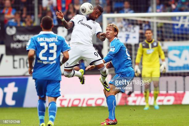 KevinPrince Boateng of Schalke controles the ball ahead of Jannik Vestergaard and Sejad Salihovic of Hoffenheim during the Bundesliga match between...