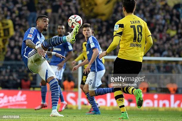 KevinPrince Boateng of Schalke plays the ball during the Bundesliga match between Borussia Dortmund and FC Schalke 04 at Signal Iduna Park on...