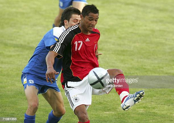 KevinPrince Boateng vies for the ball with Andreas Papanastasiou of Cyprus during the UEFA Under 19 qualification round between Germany and Cyprus at...