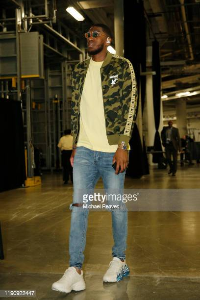 Kevon Looney of the Golden State Warriors arrives at American Airlines Arena prior to the game against the Miami Heat on November 29 2019 in Miami...