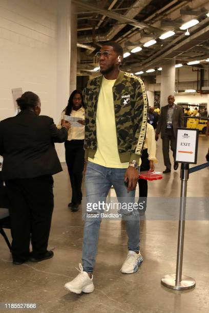 Kevon Looney of the Golden State Warriors arrives prior to a game against the Miami Heat on November 29 2019 at American Airlines Arena in Miami...