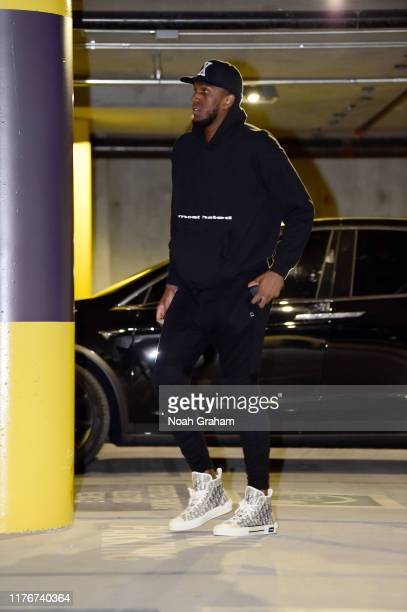 Kevon Looney of the Golden State Warriors arrives to a preseason game against the Los Angeles Lakers on October 18 2019 at Chase Center in San...