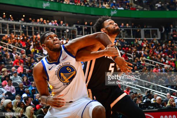 Kevon Looney of the Golden State Warriors boxes out Jabari Parker of the Atlanta Hawks on December 2 2019 at State Farm Arena in Atlanta Georgia NOTE...