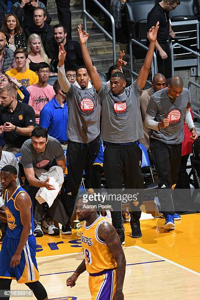 Kevon Looney of the Golden State Warriors celebrates a three point basket from the bench during the game against the Los Angeles Lakers on November 4...
