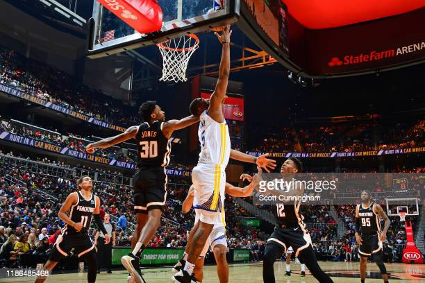 Kevon Looney of the Golden State Warriors drives to the basket and shoots the ball against the Atlanta Hawks on December 2 2019 at State Farm Arena...