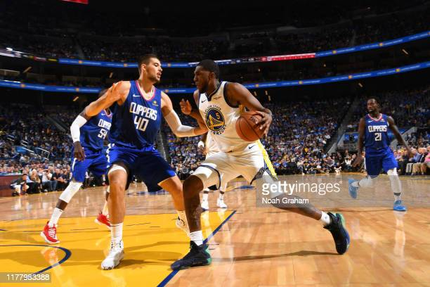 Kevon Looney of the Golden State Warriors drives to the basket against the LA Clippers on October 24 2019 at Chase Center in San Francisco California...