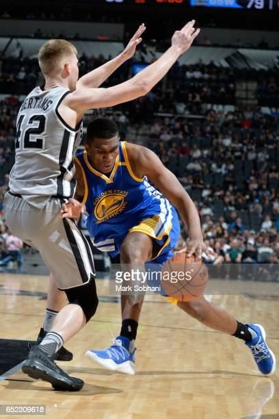Kevon Looney of the Golden State Warriors drives to the basket against the San Antonio Spurs on March 11 2017 at the ATT Center in San Antonio Texas...