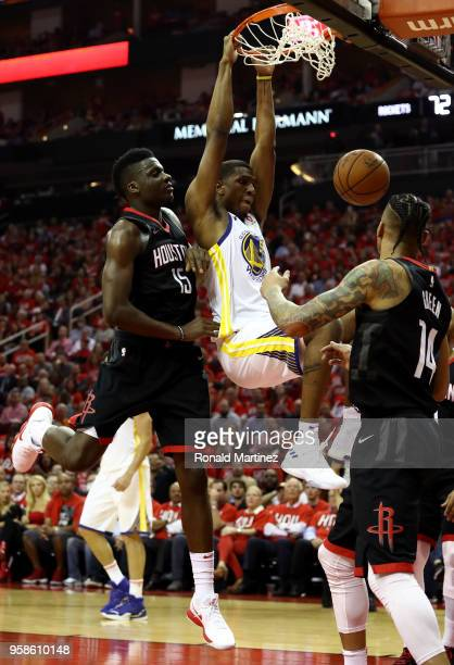 Kevon Looney of the Golden State Warriors dunks against Clint Capela of the Houston Rockets in the third quarter in Game One of the Western...