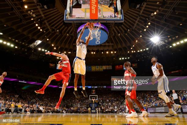 Kevon Looney of the Golden State Warriors dunks against the Washington Wizards on October 27 2017 at ORACLE Arena in Oakland California NOTE TO USER...
