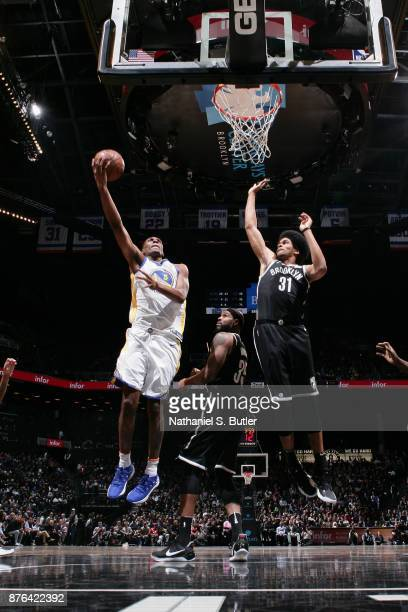 Kevon Looney of the Golden State Warriors goes to the basket against the Brooklyn Nets on November 19 2017 at Barclays Center in Brooklyn New York...