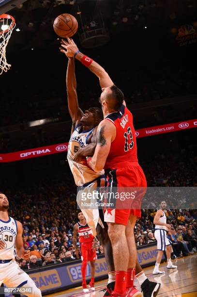 Kevon Looney of the Golden State Warriors goes up for a rebound against the Washington Wizards on October 27 2017 at ORACLE Arena in Oakland...