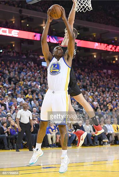 Kevon Looney of the Golden State Warriors goes up to shoot and has his shot blocked by Meyers Leonard of the Portland Trail Blazers during an NBA...