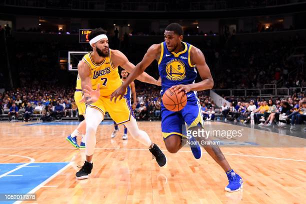 Kevon Looney of the Golden State Warriors handles the ball against the Los Angeles Lakers on October 12 2018 at SAP Center in San Jose California...