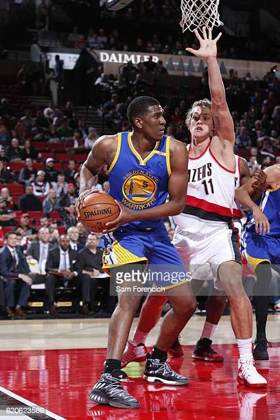 Kevon Looney of the Golden State Warriors handles the ball against Meyers Leonard of the Portland Trail Blazers on November 1 2016 at the Moda Center...