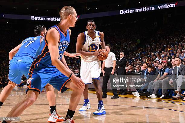 Kevon Looney of the Golden State Warriors handles the ball against the Oklahoma City Thunder on November 3 2016 at ORACLE Arena in Oakland California...
