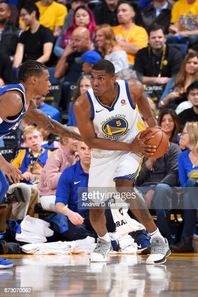 Kevon Looney of the Golden State Warriors handles the ball against the Philadelphia 76ers on November 11 2017 at ORACLE Arena in Oakland California...