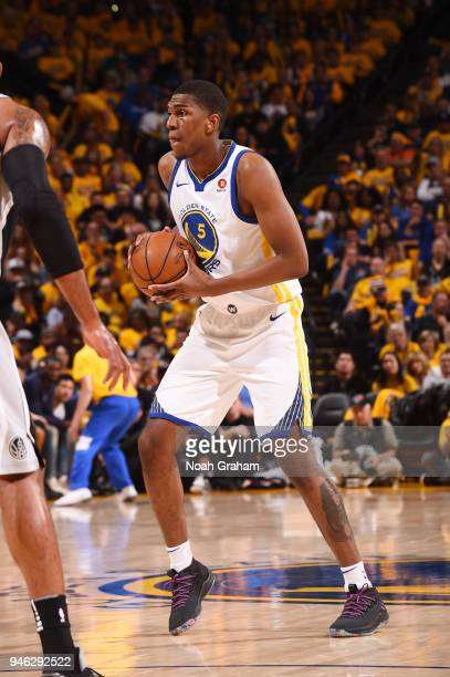 Kevon Looney of the Golden State Warriors handles the ball against the San Antonio Spurs in Game One of Round One of the 2018 NBA Playoffs on April...