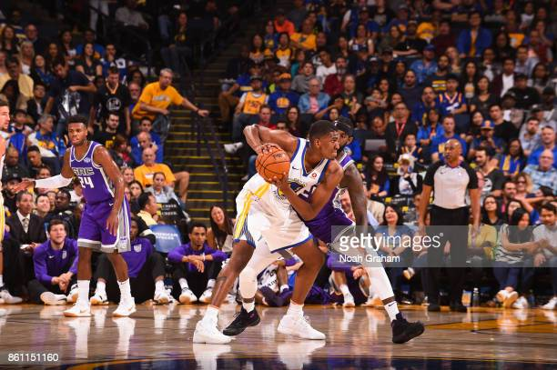 Kevon Looney of the Golden State Warriors handles the ball during preseason game against the Sacramento Kings on October 13 2017 at ORACLE Arena in...