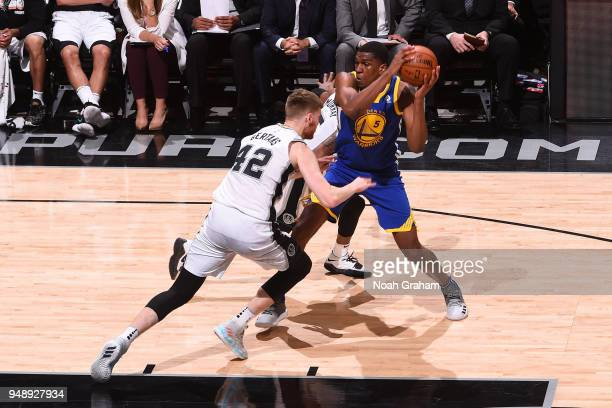 Kevon Looney of the Golden State Warriors handles the ball during the game against the San Antonio Spurs in Game Three of Round One of the 2018 NBA...