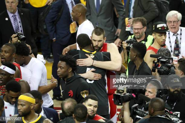 Kevon Looney of the Golden State Warriors hugs Marc Gasol of the Toronto Raptors after the Toronto Raptors win the game and become the 2019 NBA...