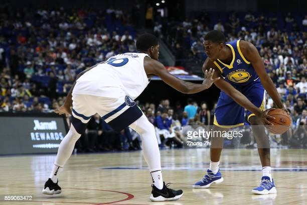 Kevon Looney of the Golden State Warriors in action against Amile Jefferson of the Minnesota Timberwolves during the game between the Minnesota...