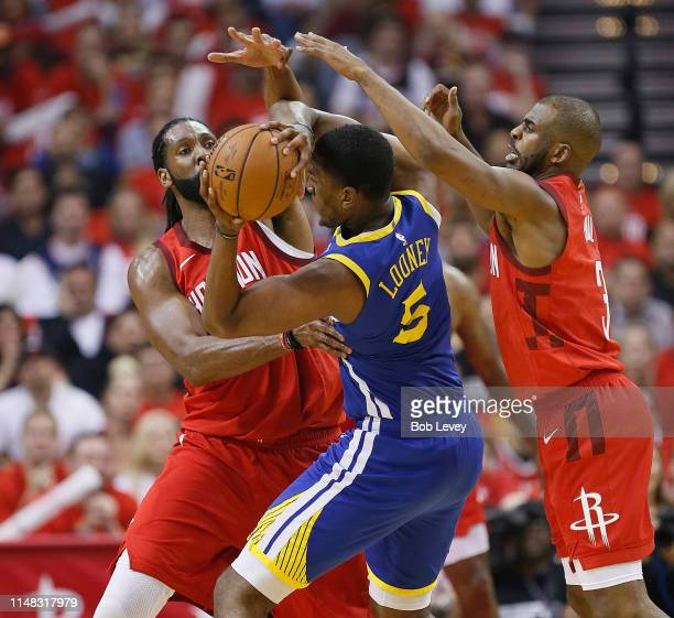 Kevon Looney of the Golden State Warriors is defended by Nene Hilario of the Houston Rockets and Chris Paul during Game Six of the Western Conference...
